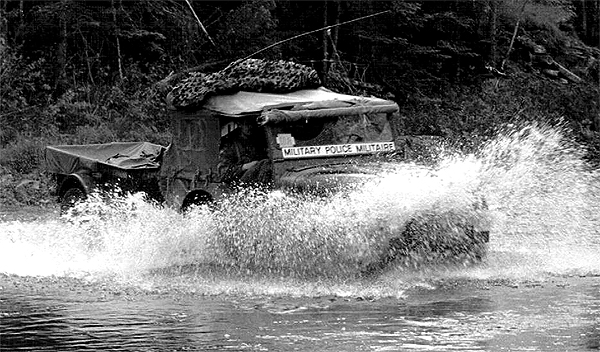 MP Jeep Team forging a river.