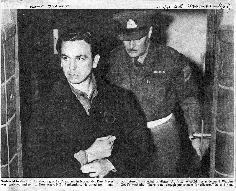 Photo of the infamous Kurt Meyer being escorted by Major Stewart-1946.