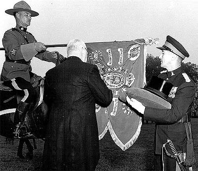 photo of C Pro C badge being attached to the RCMP Guidon-1957.